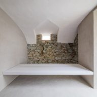 Béres Architects reveals old stone walls in Hungarian guesthouse renovation