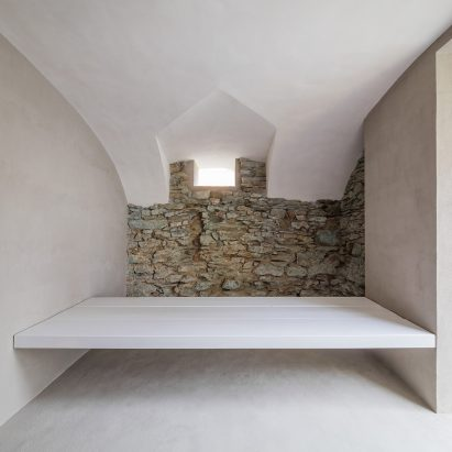bres architects reveals old stone walls in hungarian guesthouse renovation
