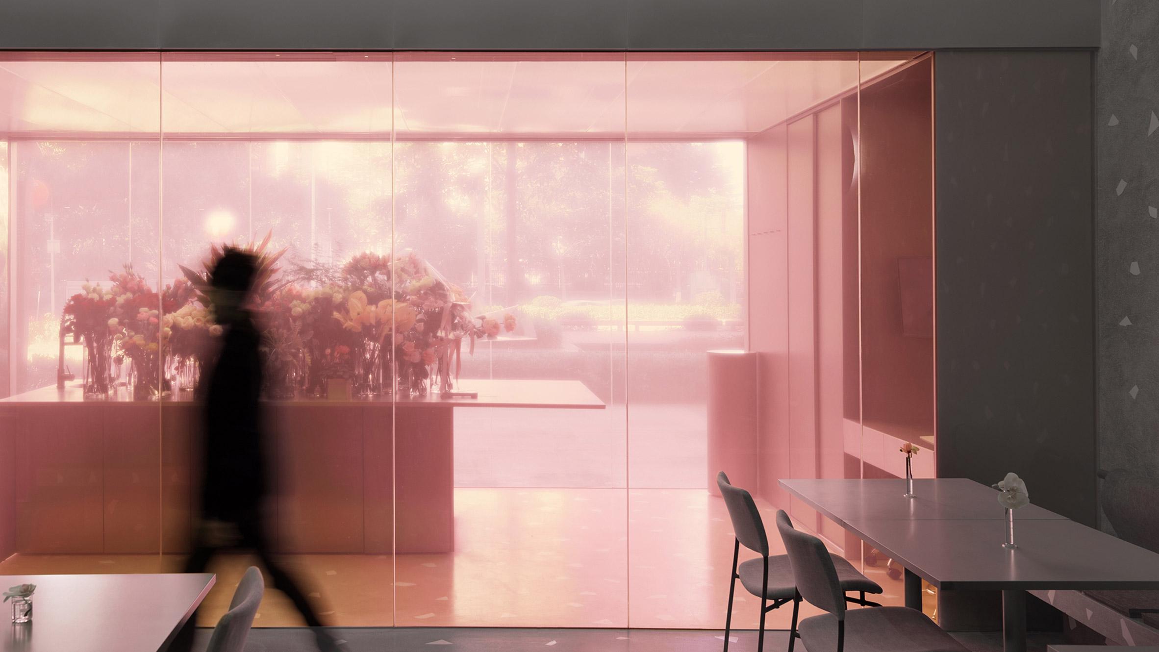 Translucent Pink Box Encloses Florist At Restaurant In Southern China