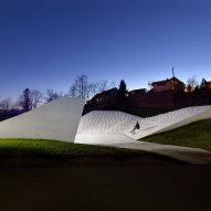 Sloping concrete volumes form open-air chapel in Slovenian village