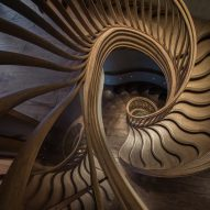 Sinuous timber staircase by Atmos Studio spirals up through London restaurant HIDE