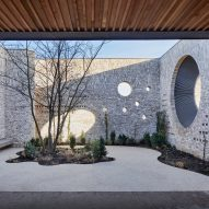Porthole openings connect community centre and kindergarten in Cambridge