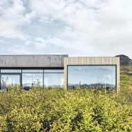 Timber and concrete summer house faces scenic Icelandic landscape