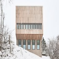 Timber-and-glass boxes contain pair of residences on a Norwegian hillside
