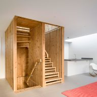 Hundreds of timber components form statement staircase for London house