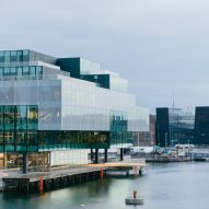 OMA stacks green glass boxes to create BLOX architecture centre on Copenhagen waterfront