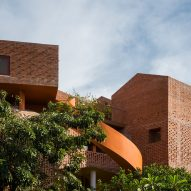 Chuon Chuon Kim Kindergarten by Kientruc O looks like a cluster of brick houses