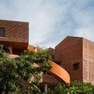 Chuon Chuon Kim Kindergarten by Kientruc O looks like a cluster of brick houses