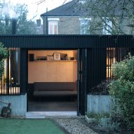 Eckford Chong adds blackened-timber garden studio to refurbished London house