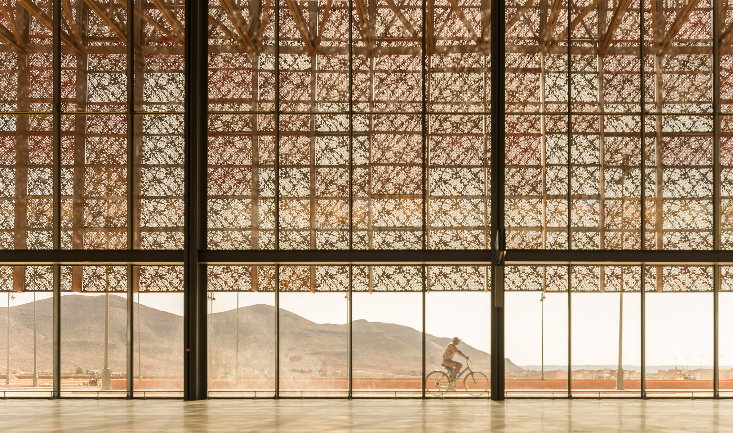 Guelmim Airport is wrapped in a skin of multihued perforated panels