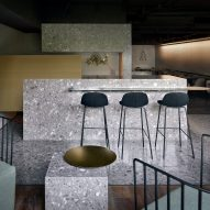Blocks of grey terrazzo set the tone of muted pizza restaurant in Beijing