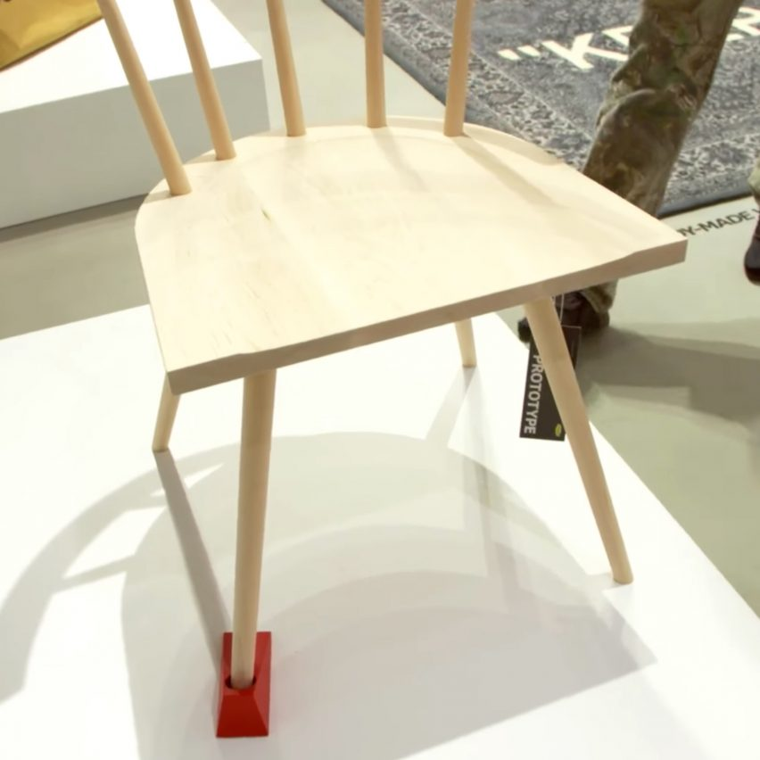 One Of The Products Unveiled Was Door Stop Interruption, A Simple Wooden  Chair With A Bright Red Doorstop On One Of Its Legs