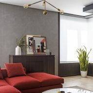 Archetype use rich-toned walls and furnishings for redesign of Moscow flat