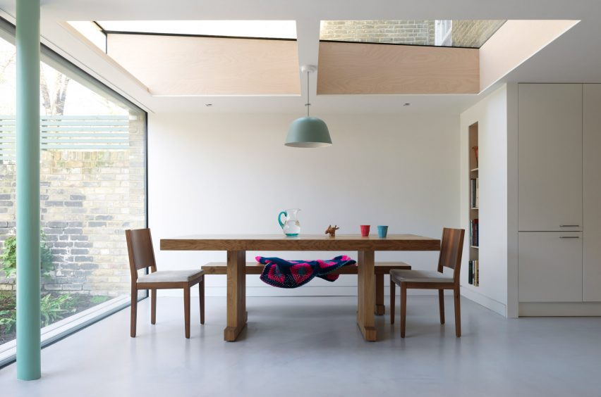 Glazed extension seamlessly connects refurbished Highbury house with new patio garden