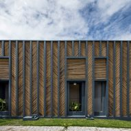 Vilela Florez designs Bamboo House with chevron-patterned exterior in rural Brazil