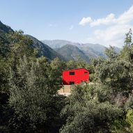 Felipe Assadi's bright red Casa La Roja nestles in the Chilean mountains