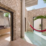 Swimming pool flows between courtyard walls of Mexico's Casa Xólotl