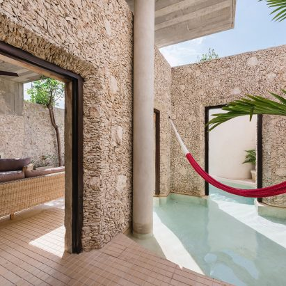 Swimming Pool Flows Between Courtyard Walls Of Mexicou0027s Casa Xólotl