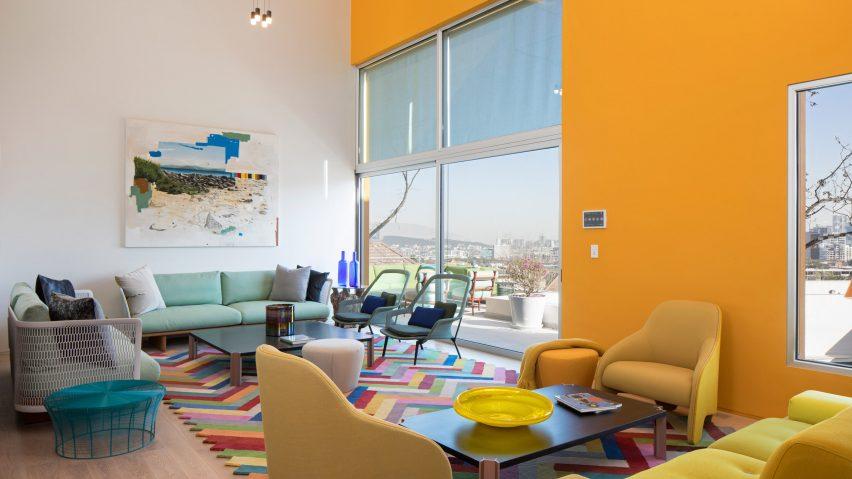 Eight Home Interiors Furnished Around Statement Rugs