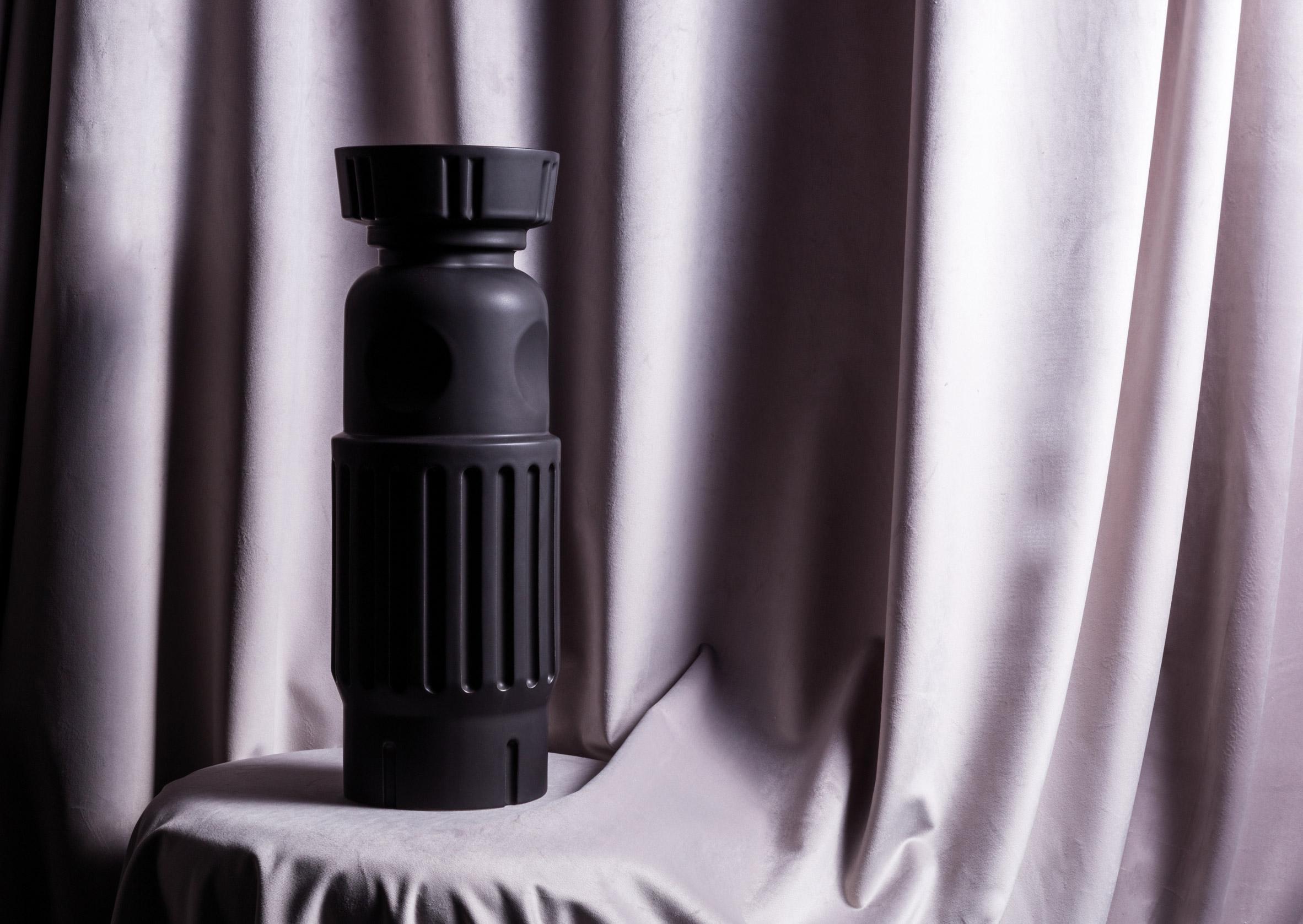 Visser & Meijwaard create black vessels inspired by traditional Dutch cabinets