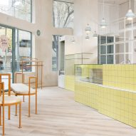 Baking ingredients inform soft-hued interiors of Juana Limón cafe in Madrid