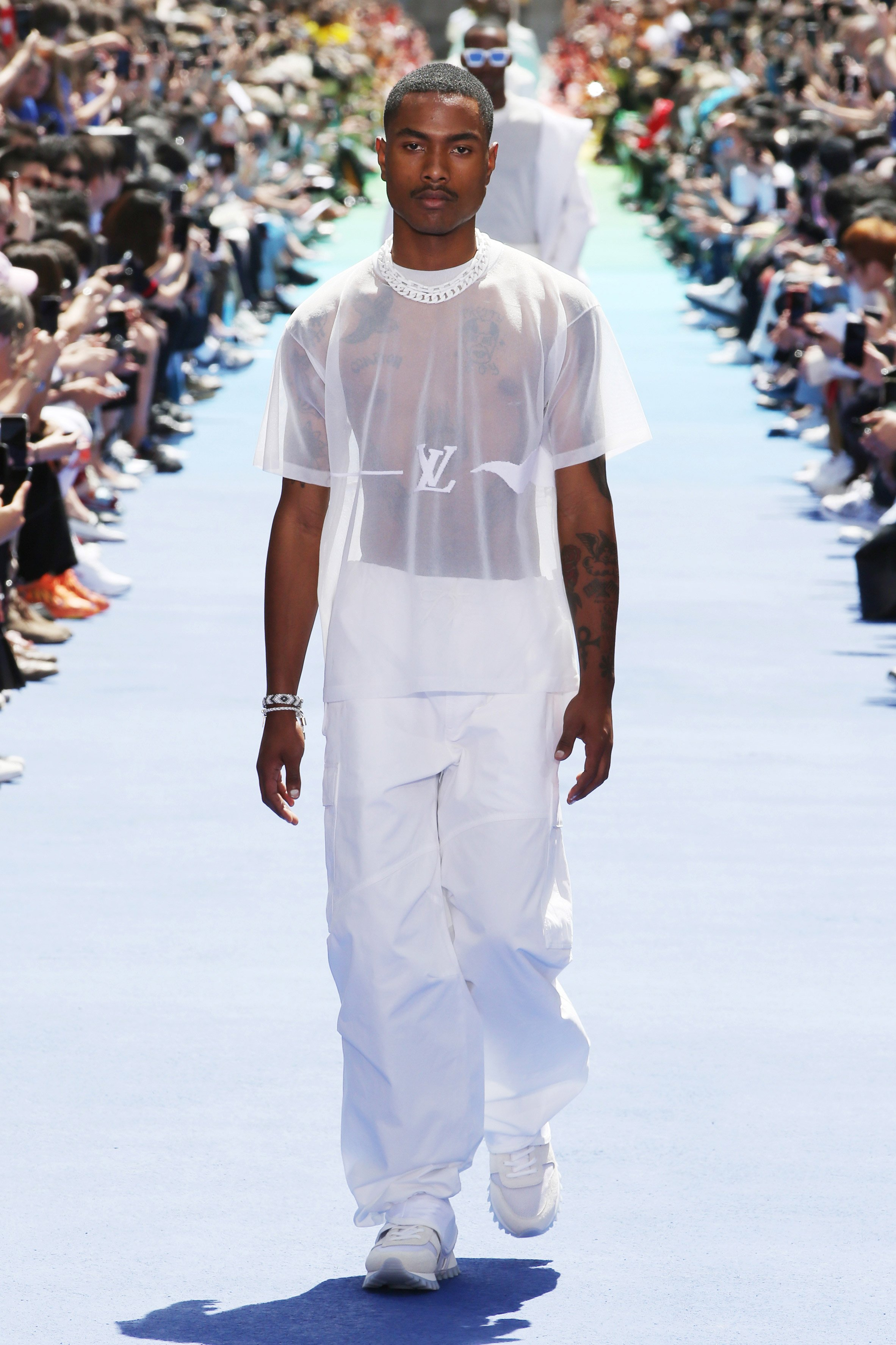 6480ce0bb ... Virgil Abloh makes debut for Louis Vuitton at Paris with rainbow runway  ...