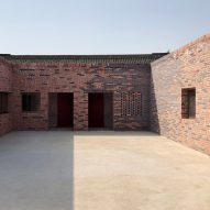 Peach House is a contemporary brick-clad courtyard house in Beijing