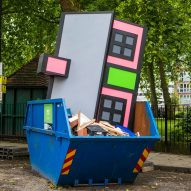 Richard Woods dumps one of his cartoon houses in a London skip