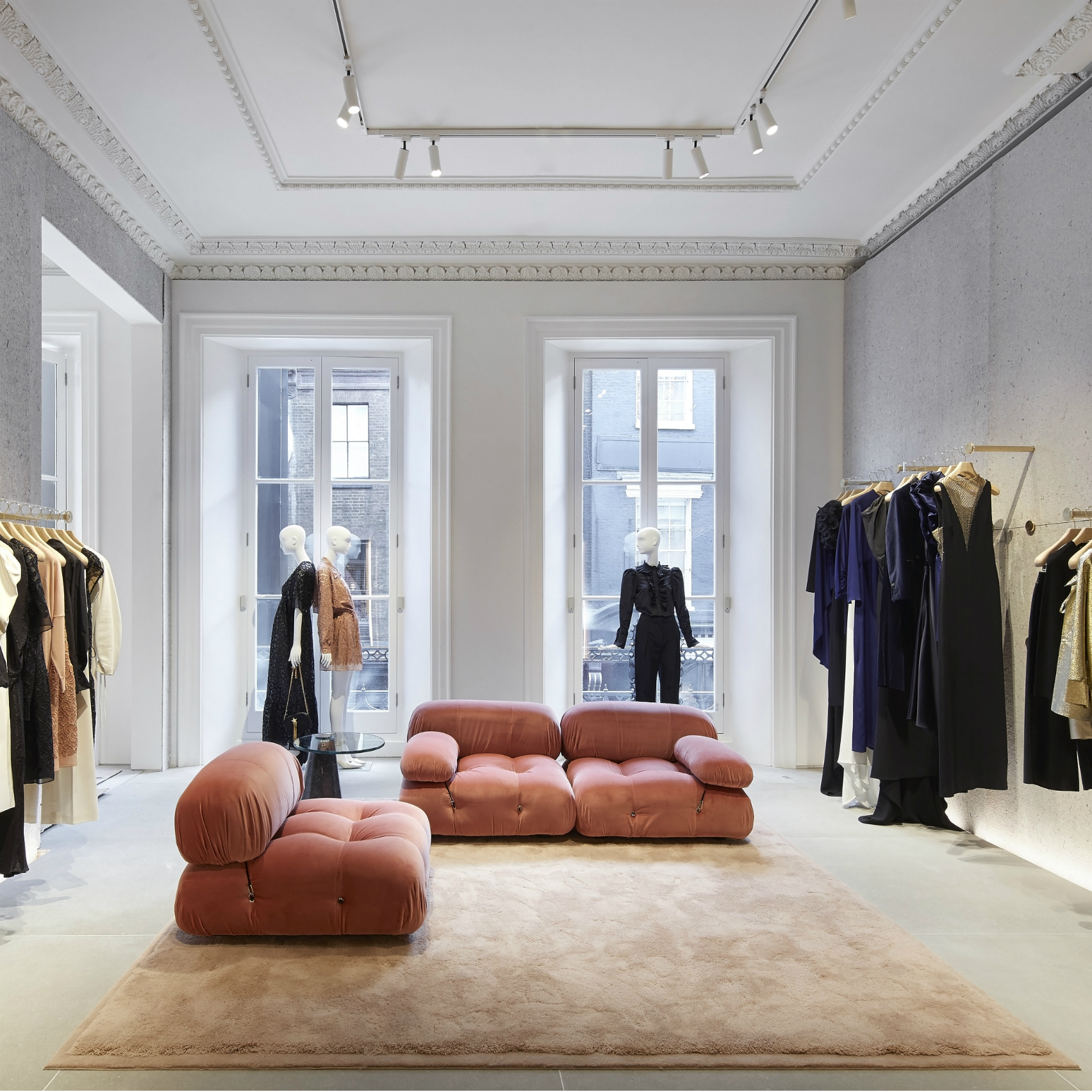 Pink Mario Bellini sofas from Stella McCartney's personal collection sit on the womenswear floor