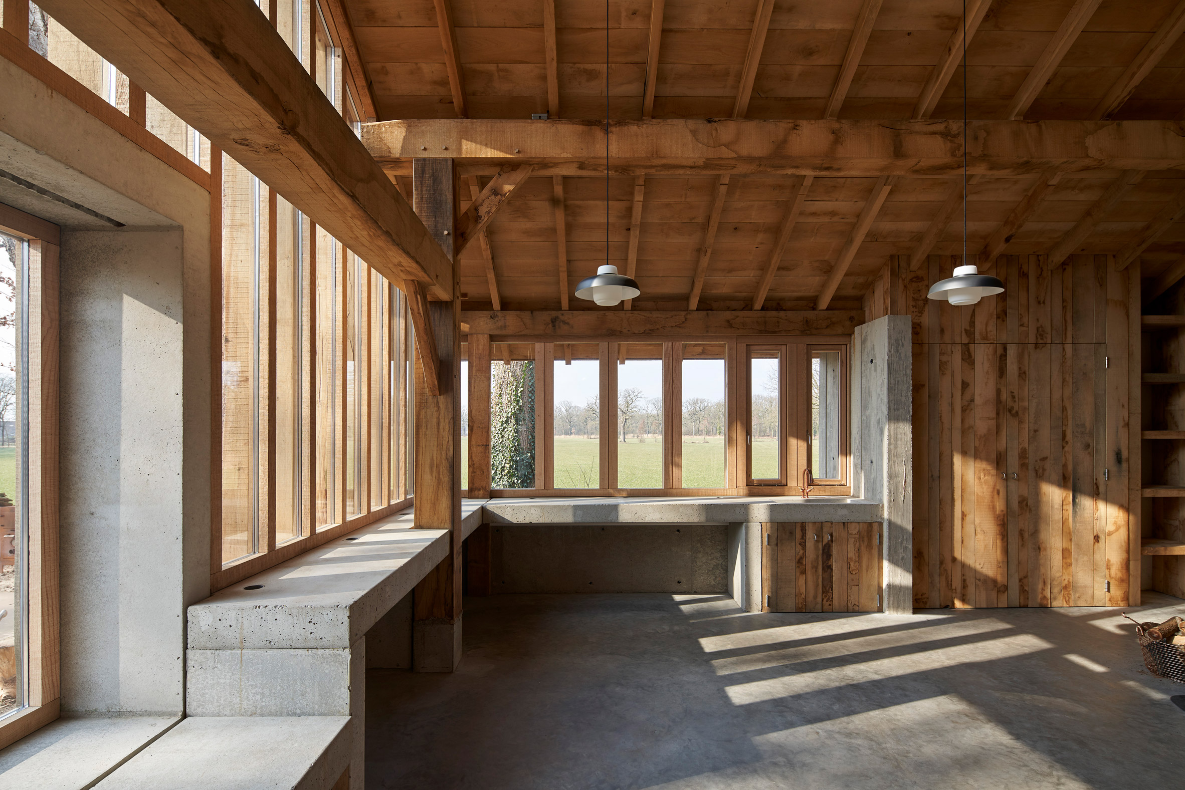 Hilberinkbosch Architects Builds Timber And Glass Barn Using Wood Felled