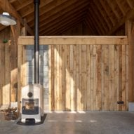 HilberinkBosch Architects builds timber and glass barn using wood felled from their own land