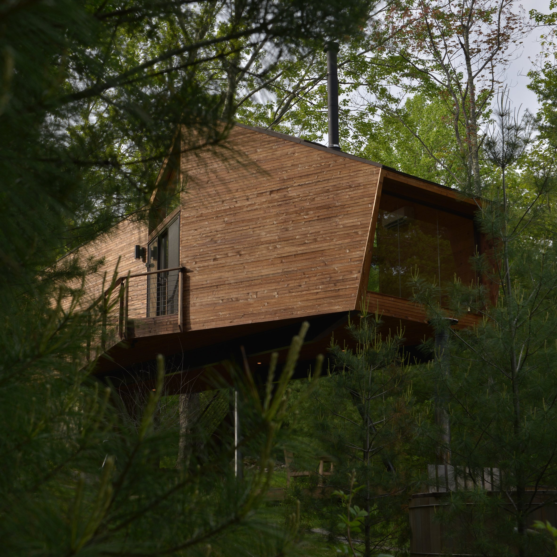 Antony Gibbon builds stilted wooden treehouse in Upstate New York forest