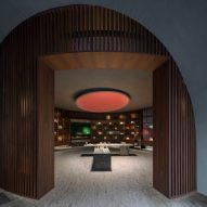 Neri&Hu's atmospheric Valextra store is based upon the layout of a library