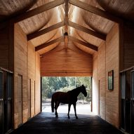 Elongated skylight illuminates stables in Chile by Matias Zegers Architects