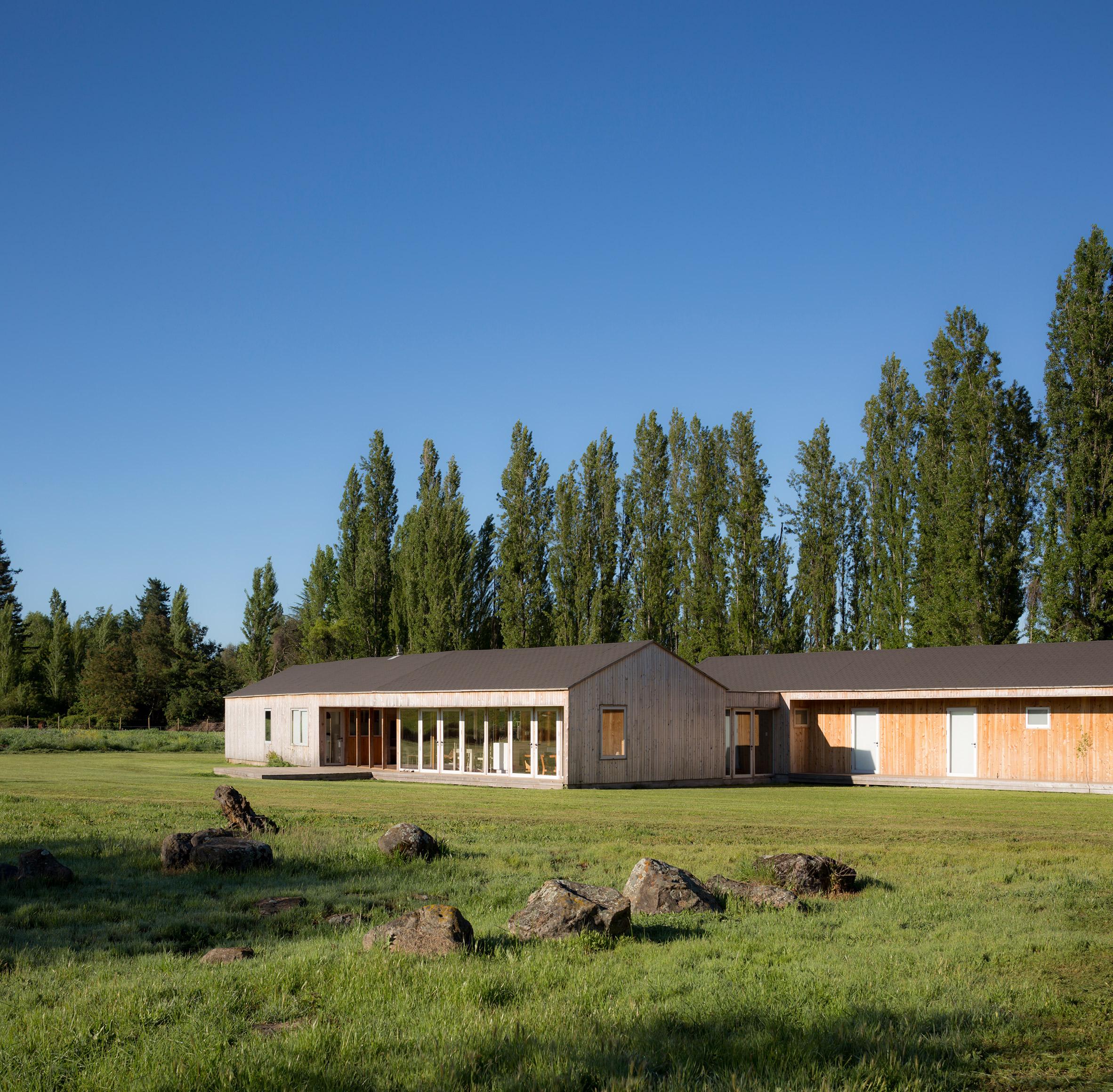 Ignacio Correa crafts wooden Casa Camilo for family of farmers in Chile