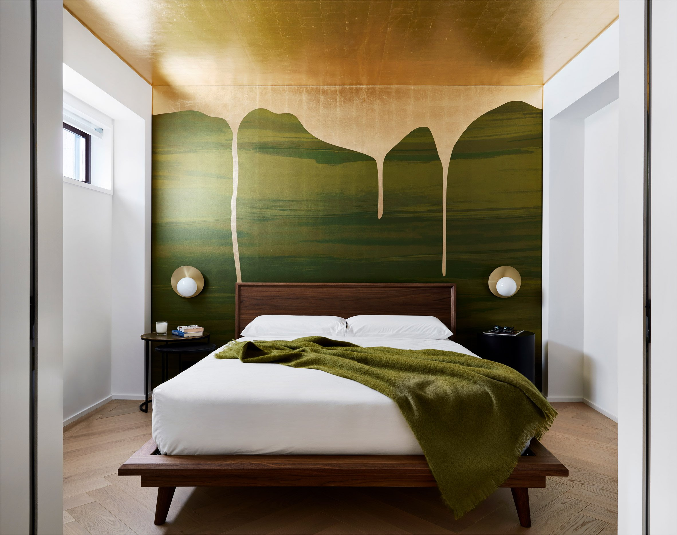 Gold paint drips down green mural at Chelsea Pied-à-Terre by Stadt Architecture