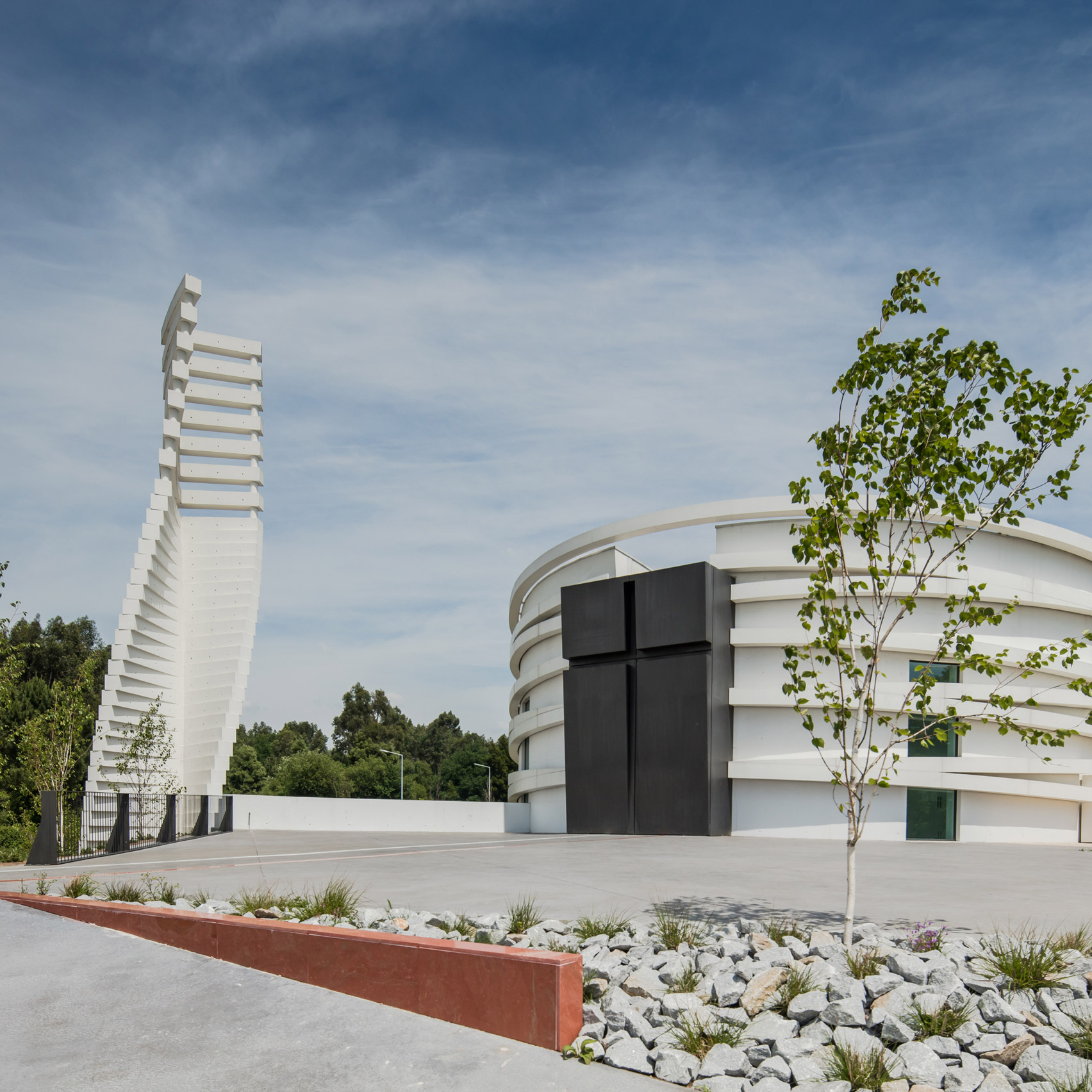 Hugo Correia creates elliptical concrete church in Portugal
