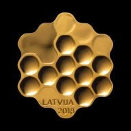 Arthur Analts designs honeycomb coin in tribute to Latvia