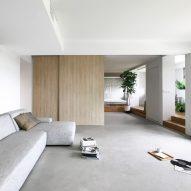 """Nitton Architects knock through walls to create """"mini house"""" inside Singapore flat"""