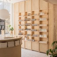 O'Sullivan Skoufoglou pairs wooden cabinets with peach hues for RÖ Skin shop