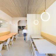 Rane Interiors outfits Japanese restaurant Saku with orange and cream surfaces
