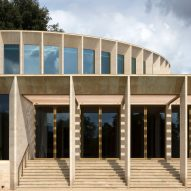 Niall McLaughlin Architects adds stone-clad auditorium to Oxford college campus