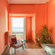 Waterfront Nikis Apartment features walls in shades of pink, blue and green