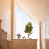 AWE Office creates apartment building with angular stone-clad facade in Iran
