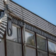 Alex Chinneck unzips the walls of a building in latest installation