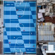 Chequered blue sports venue reinvigorates impoverished Mexico City neighbourhood