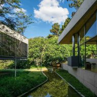 Casa em Cotia in São Paulo features a snaking pond and a rooftop garden