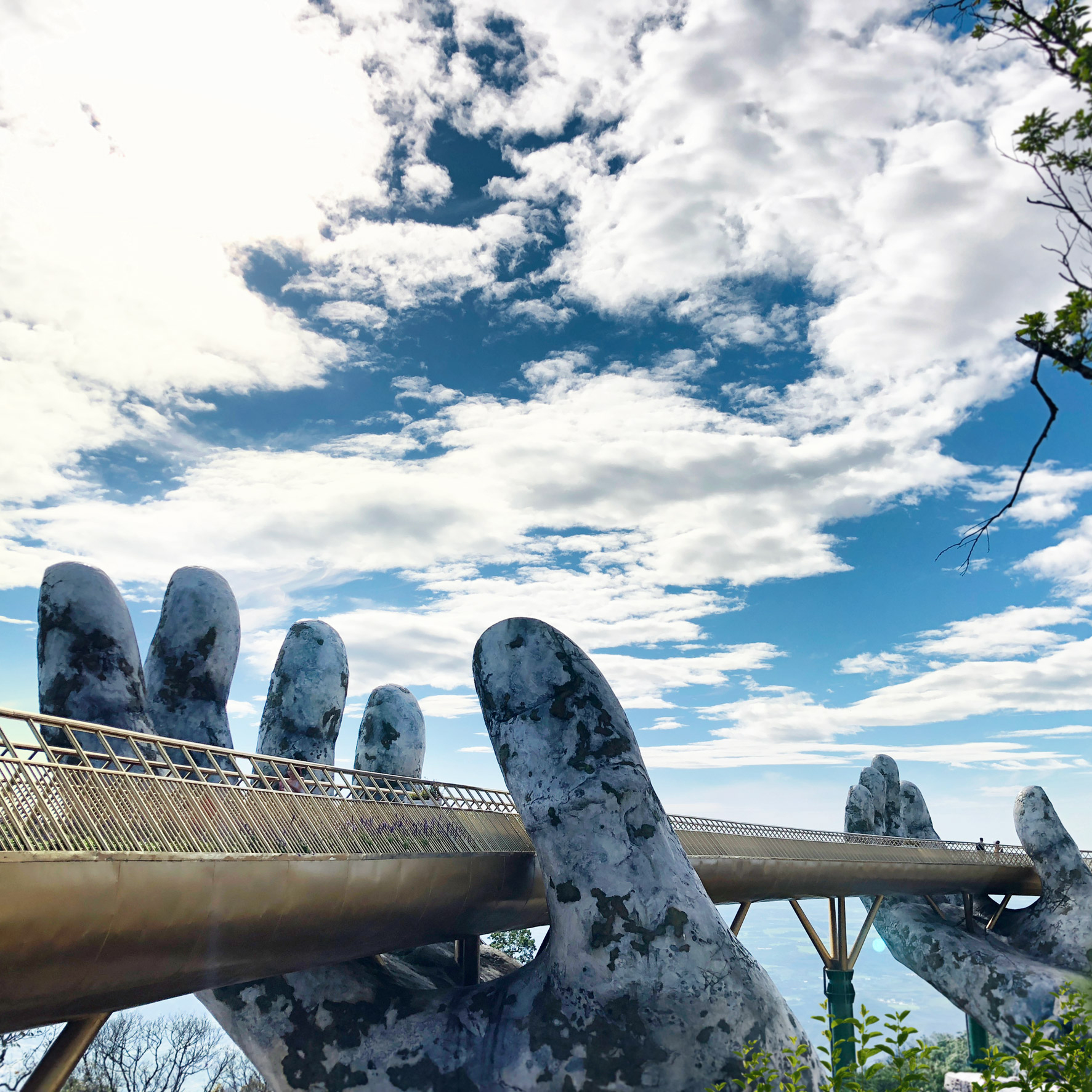 Two Giant Hands Hold Up Golden Bridge In Vietnam