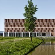 Brick relief facade evokes bookshelves at Delft archive building