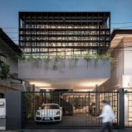Flower Cage House is a Bangkok home with a facade of olive trees